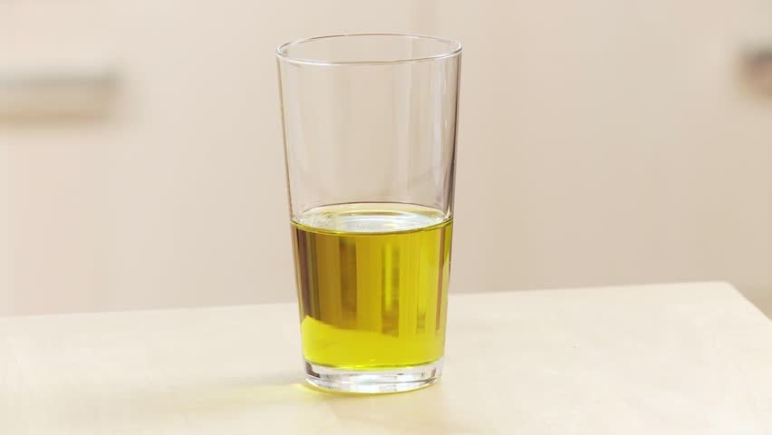 Olive oil in a drinking glass
