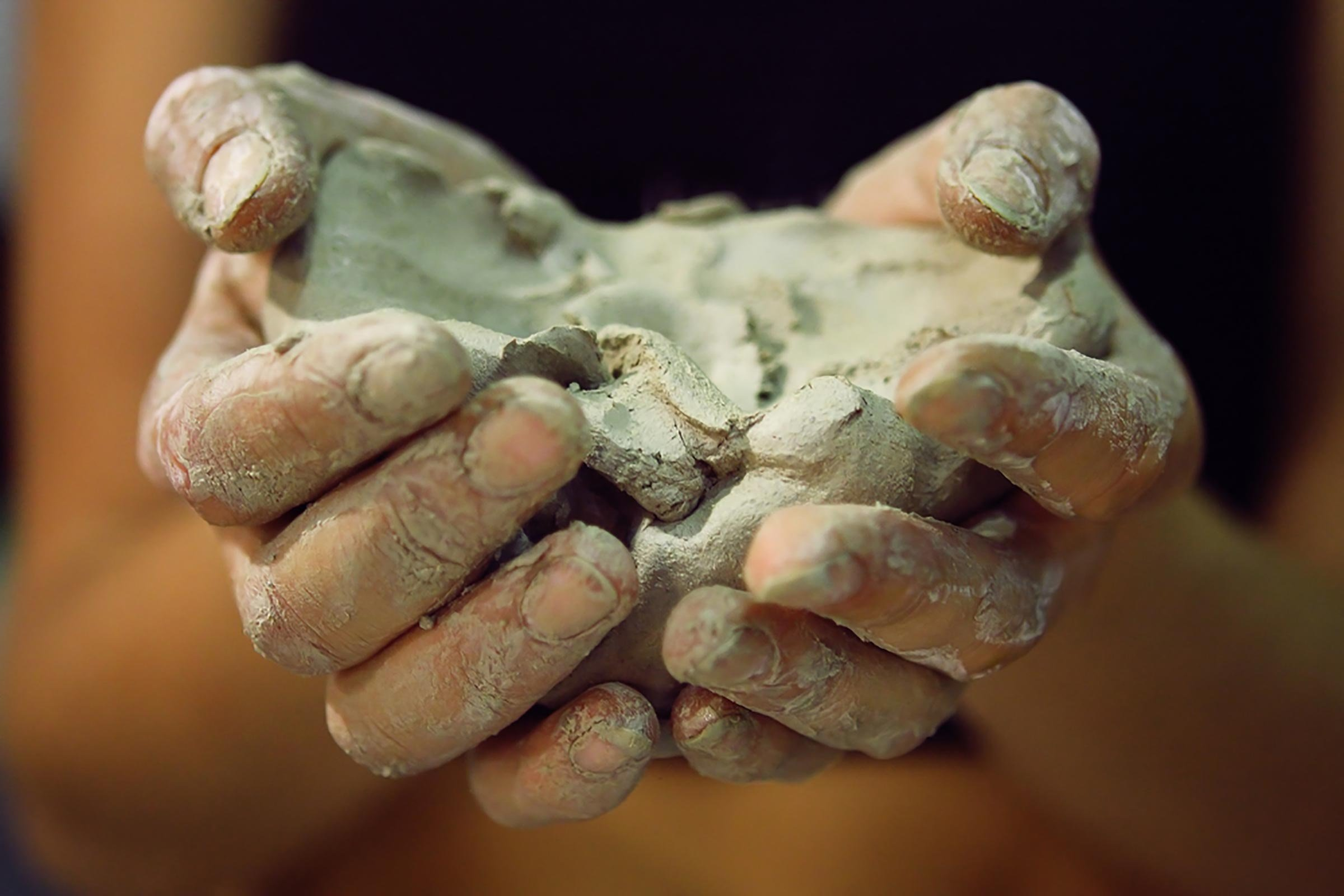Molded clay on hands